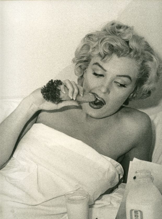 monroe eating a carrot