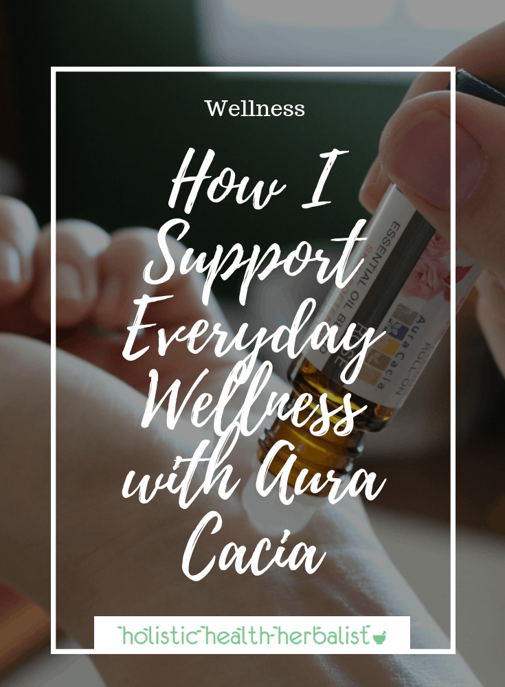 How I Support Everyday Wellness with Aura Cacia - photo of using a roll-on on the wrist